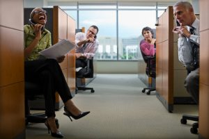 Businesspeople Irritated by Loud Cowork in Cubicle --- Image by © Tim Pannell/Corbis
